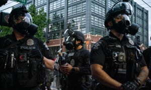 Police officers face off with demonstrators in early June in Seattle.
