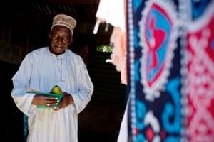 Kombo Mohamed poses at his home in Stone Town, Zanziba