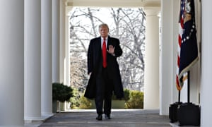 President Donald Trump walks through the Colonnade from the Oval Office of the White House to announce a deal to temporarily reopen the government on Friday.