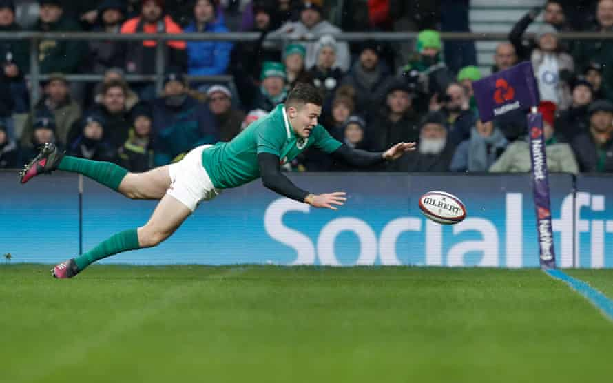 Jacob Stockdale dives to score Ireland's third try in the extra area created by England wanting a deeper dead-ball line during the England v Ireland Six Nations Championship International Rugby Union match at Twickenham in March 2018