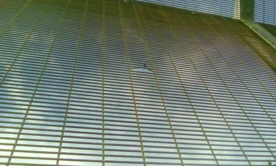 A supplied image showing the damage to a mesh screen at the Manus Island detention centre that was caused during a violent altercation on Friday.
