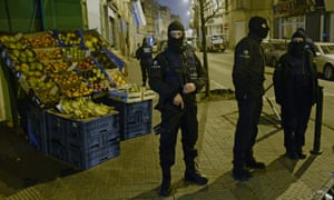 Policemen stand guard in Molenbeek after last week's attacks.
