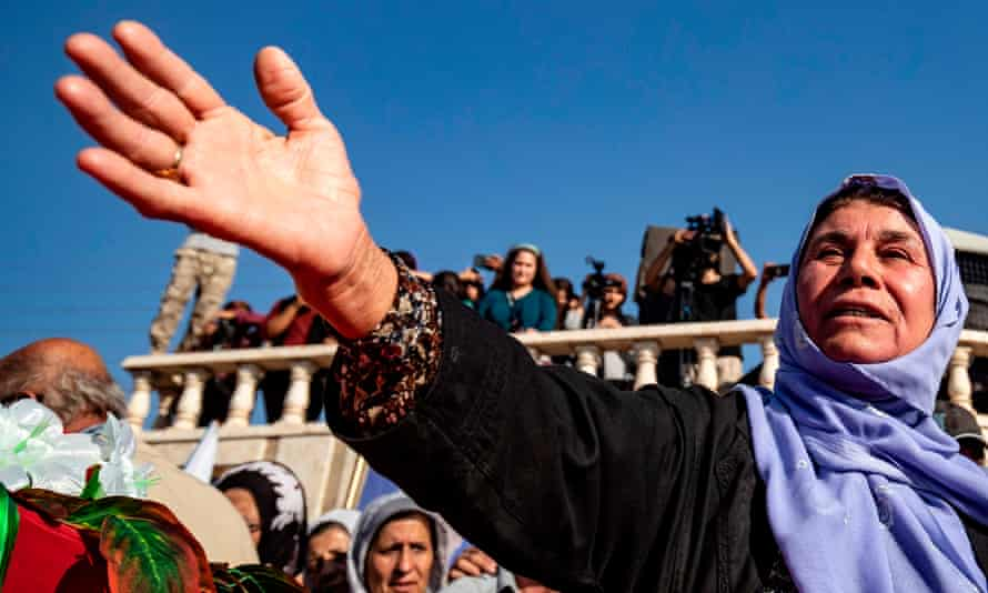 Mourners attend a funeral for Kurdish political leader Hevrin Khalaf and others, including civilians and Kurdish fighters, in the north-eastern Syrian Kurdish town of Derik.