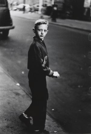 Life spills out of them … Boy stepping off the curb, NYC 1957–58, by Diane Arbus.