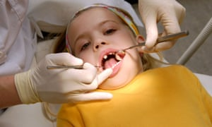 A child being examined by a dentist