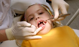 Child having teeth checked by dentist
