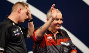 Phil Taylor celebrates his 3-1 defeat of Chris Dobey on day two of the World Darts Championship at Alexandra Palace on Friday night.