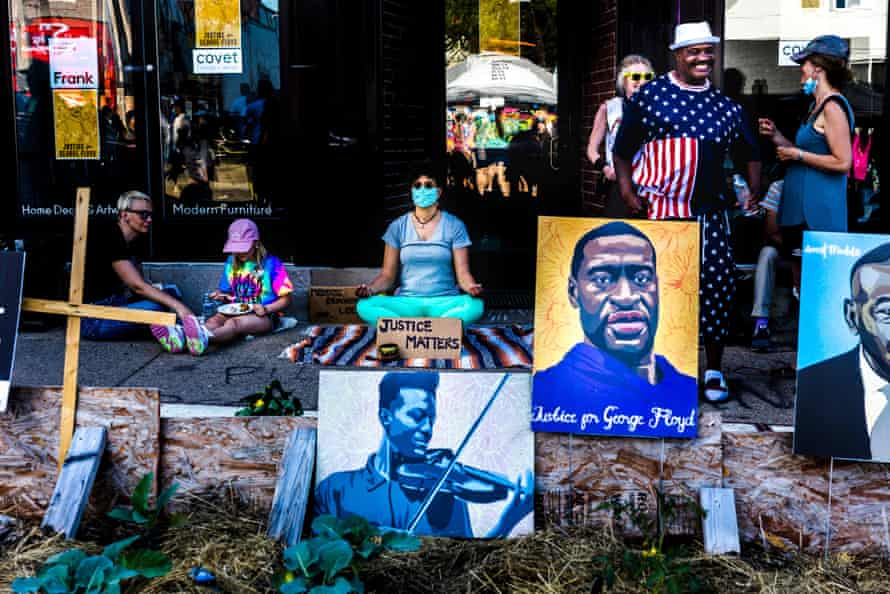 A woman meditates on the anniversary of the police murder of George Floyd, at George Floyd Memorial Square in Minneapolis.