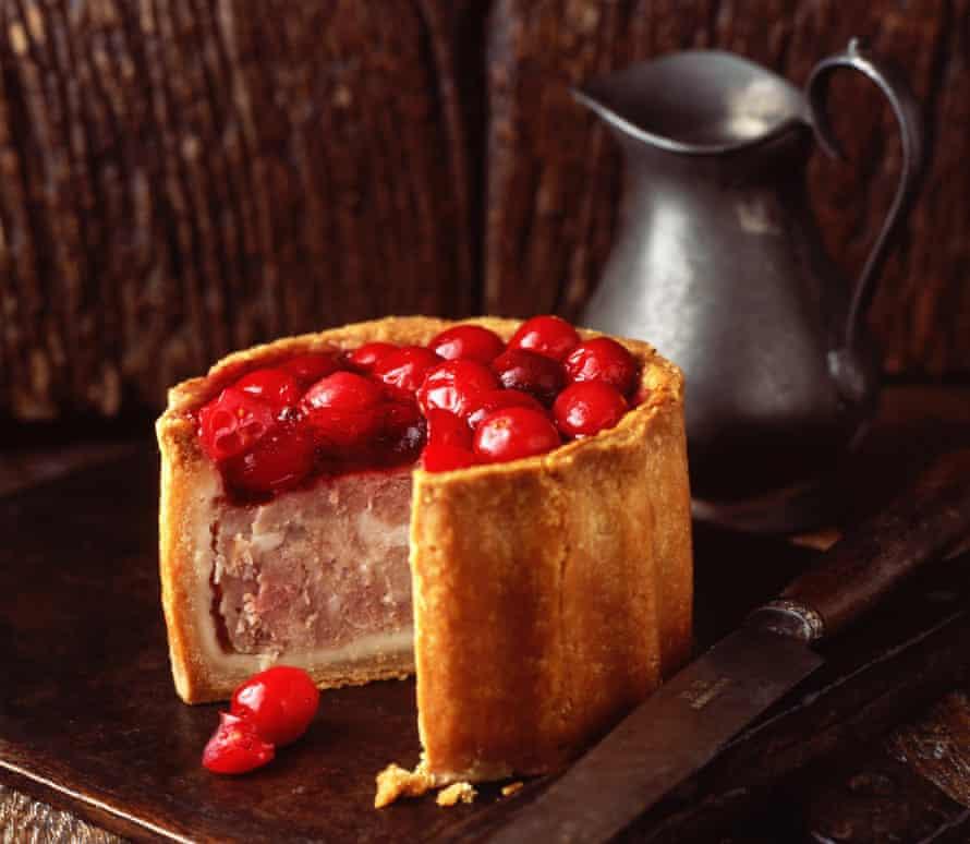 A cranberry topped raised pork pie.