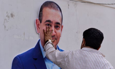 A cardboard cut-out of billionaire jeweller Nirav Modi at a protest against him in New Delhi in February.