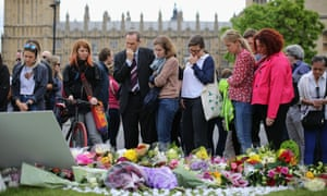 People gather in Parliament Square in London to pay their respects to Jo Cox.