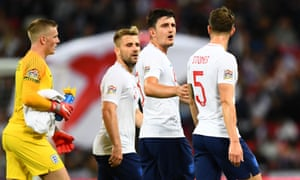Harry Maguire discusses tactics with his team-mates at half-time.