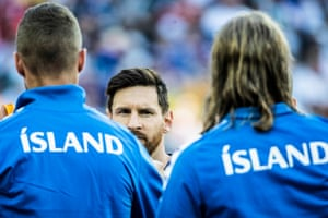 Argentina's Lionel Messi shakes hands with the Iceland players before the match at Spartak Stadium.