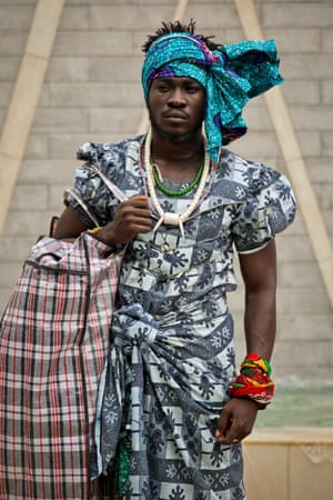 Serge Attukwei Clottey walks through Accra in his mother's clothes.