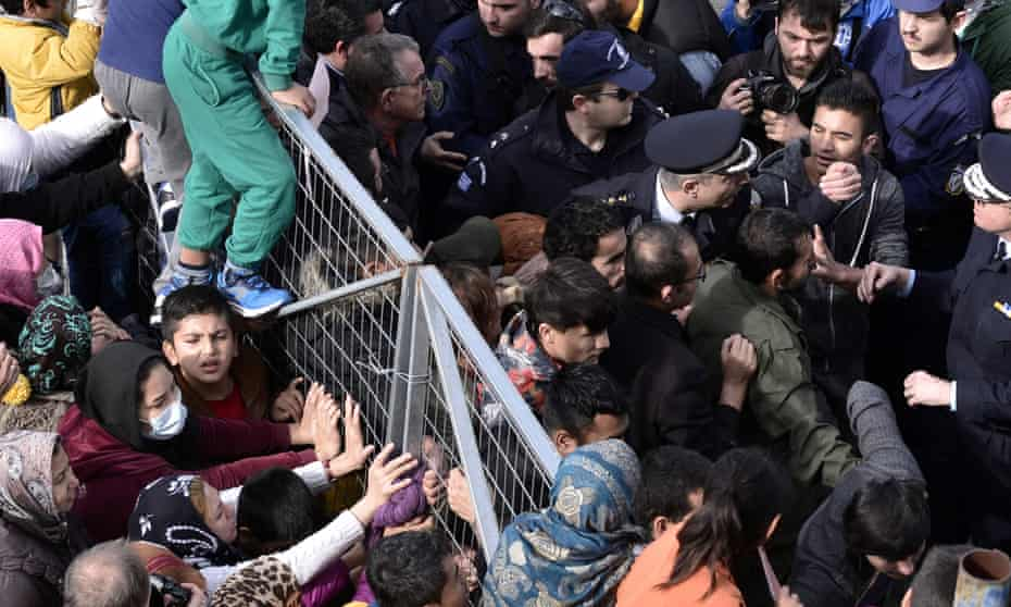 Migrants block the entrance of the Hellinikon camp in Athens during a protest over poor living conditions