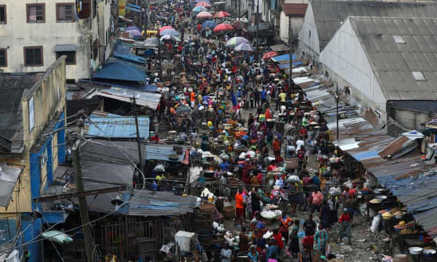 Shoppers return to a marketplace as Lagos eases the curfew imposed after protests
