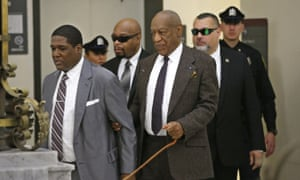 Bill Cosby, center, and his security team return to Courtroom A after a lunch break during Cosby's pre-trial hearing for sexual assault at the Montgomery County courthouse Wednesday.