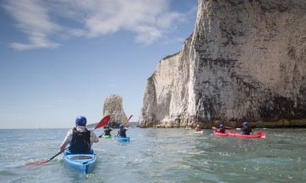Sea kayaking, Dorset coast, UK.