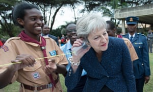 The prime minister, Theresa May, 'takes a call' on a plastic telephone