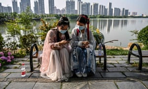 Young women on a park bench in Wuhan, 17 May