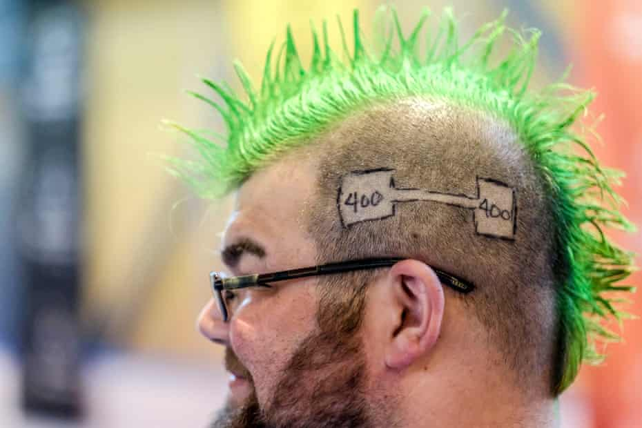 Andrew Dziezak hair carvings reflect his goal in power lifting.