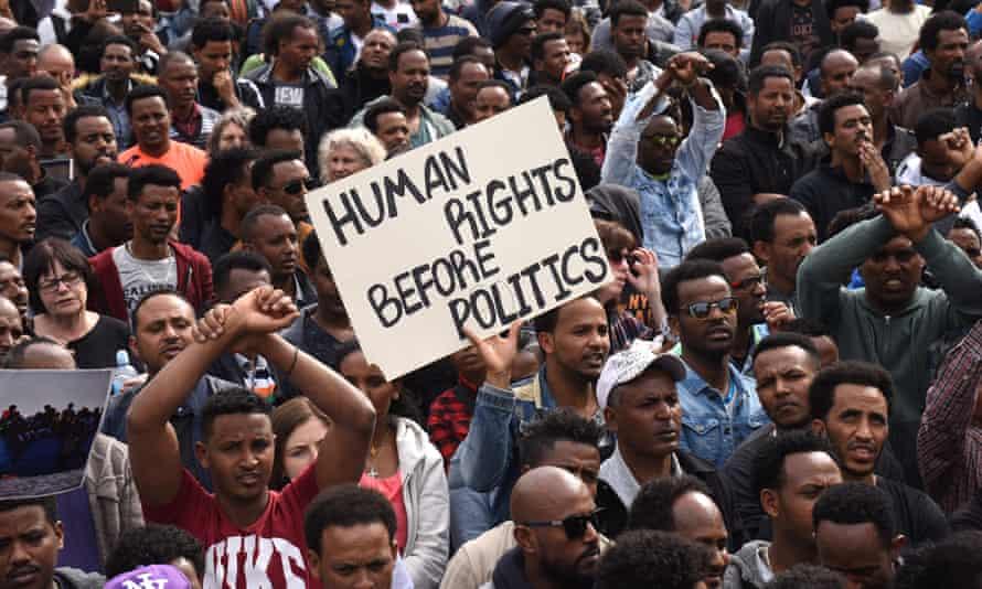 People from Sudan and Eritrea protest outside the Rwandan embassy in Herzliya, Israel