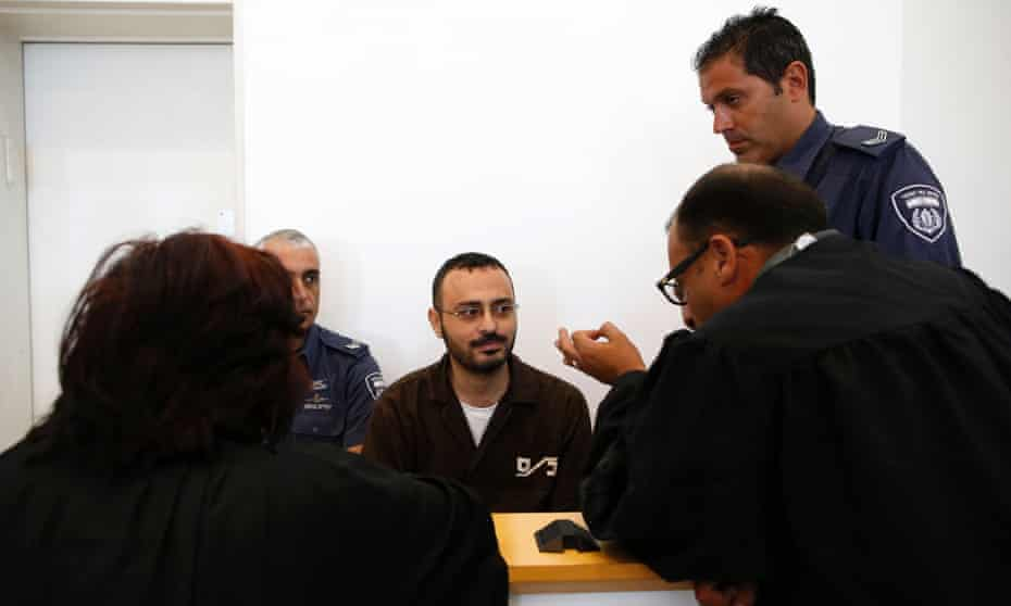 Waheed al-Borsh, a UN Development Programme employee in Gaza accused of aiding Hamas, speaks to his lawyers at Beersheva district court in 2016.