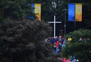 People wait ahead of a visit of Pope Francis to the Marian shrine in Knock