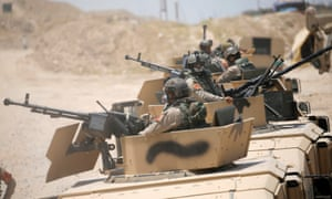 Iraqi security forces in armoured vehicles take position on the outskirts of Falluja, Iraq, on Monday.
