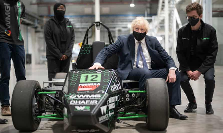 Boris Johnson visits Coventry, sits in an electric sports car