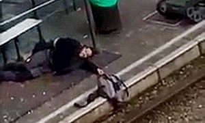 Brussels suspect holds a rucksack over tram tracks