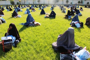 Women receive a free food ration in Kandahar.