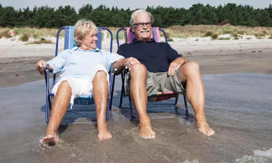 Couple in sunloungers at the beach