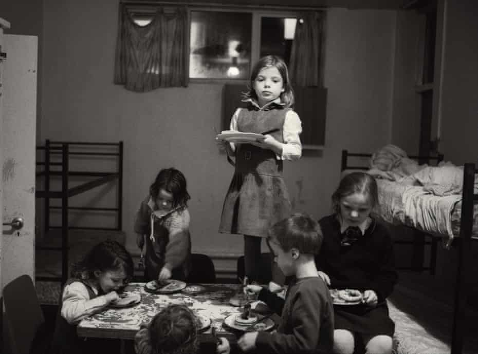 Kirsti (standing), with (clockwise from left) siblings Donna, Katrina, Emma, Mark and Jason at a hostel for homeless families in Blackpool (1992).
