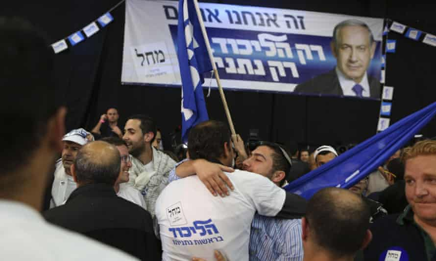 Israeli Likud Party supporters react to the exit polls while they wait for the announcement of the first official results of Israel's parliamentary elections.