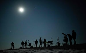 People gather as they wait for the appearance of a the blood moon total lunar eclipse over Vienna