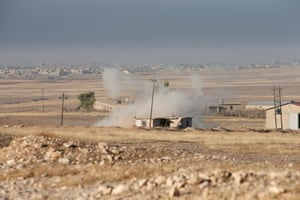 Smoke rises during clashes to the east of Mosul
