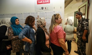 Women queue to vote at a polling station in Beirut