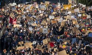 Protesters participate in a Black Lives Matter rally in Brisbane, Australia.