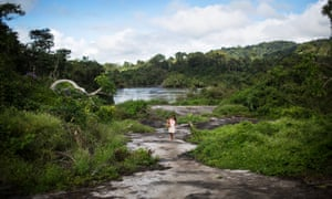 A Xikrin woman walks back to her village from the Cateté River in Brazil