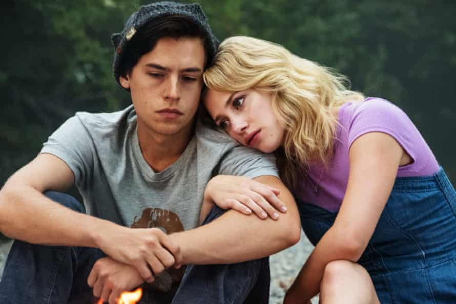 Jughead and Betty sitting by the river