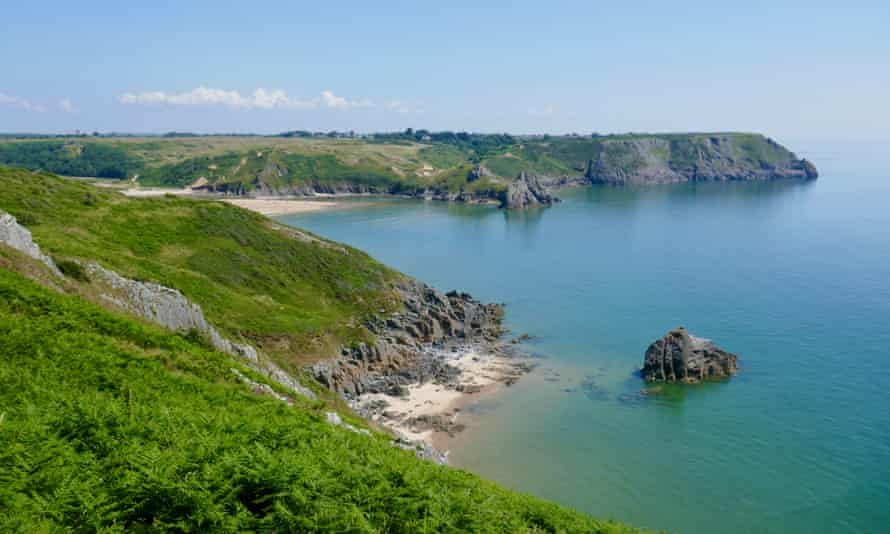 Walking to Three Cliffs Bay from Pennard on a sunny, blue-sky day. Wales, UK.