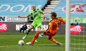 Norwich City's Teemu Pukki caresses his finishes past Christian Walton to deny Wigan a shock victory against the Championship leaders.