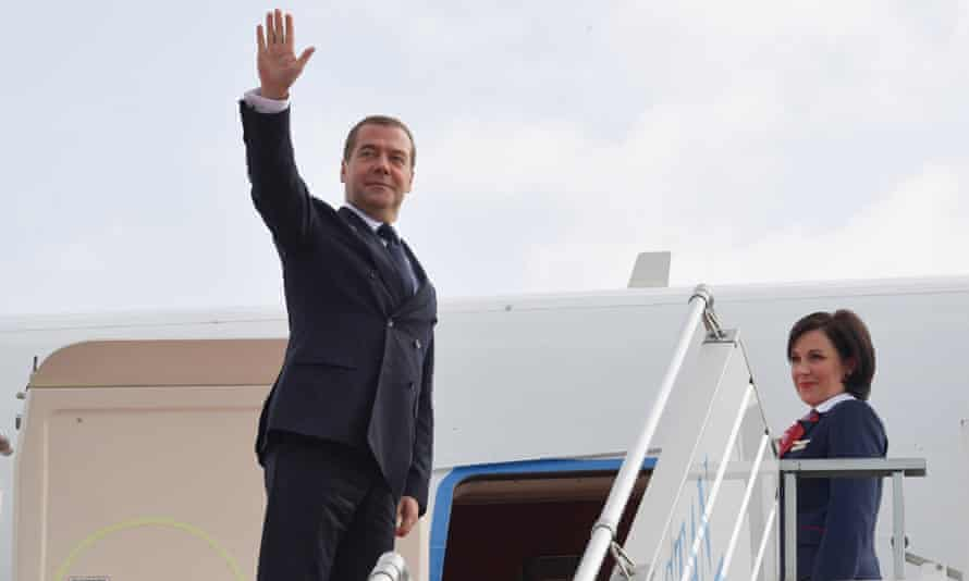 Russia's Prime Minister Dmitry Medvedev boards a plane after a meeting in Uzbekistan.