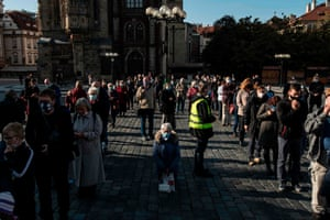 People take part in an outdoor Sunday mass at the Old Town Square in Prague on 26 October, 2020, amid the coronavirus pandemic.