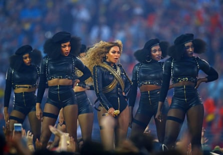 Beyonce performs at halftime with dancers in Super Bowl 50 between the Carolina Panthers and the Denver Broncos