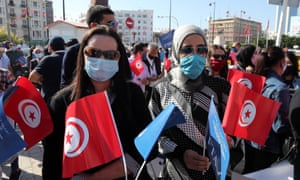 Tunisian workers in travel agencies take part in a demonstration to highlight how seriously they have been affected by the pandemic.