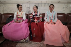 Chinese minority delegates wearing traditional costumes wait inside the Great Hall