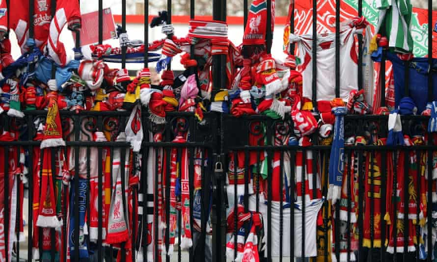 Scarves are tied to the Shankly Gates next to the Hillsborough memorial at Anfield.