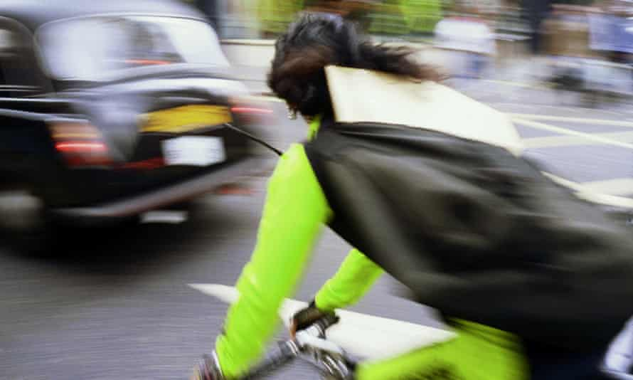 A cycle courier in London